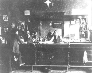 This is the interior of the Egan-McGrath saloon, which was in the Grand Central hotel at the foot of Metcalf street in Woolley, starting in the 1890s. The Sunset Beach Hotel saloon likely looked very similar.